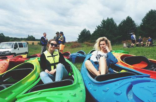 Paysera team members in kayaks